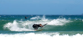 kitesurfing in waves